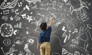 A Child Standing Before a Chalkboard of Opportunity and Adventures - will help him to Prepare for College